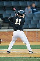 Jonathan Pryor (11) of the Wake Forest Demon Deacons at bat against the Missouri Tigers at Wake Forest Baseball Park on February 22, 2014 in Winston-Salem, North Carolina.  The Demon Deacons defeated the Tigers 1-0.  (Brian Westerholt/Four Seam Images)