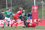 Ireland flanker Paula Fitzpatrick is tackled by Welsh pair Elinor Snowsill and Rachel Taylor.<br /> 6 Nations Championship<br /> Wales v Ireland Women<br /> St Helens Swansea<br /> 15.03.15<br /> ©Steve Pope - SPORTINGWALES