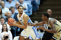CHAPEL HILL, NC - JANUARY 4: Garrison Brooks #15 of the University of North Carolina is guarded by Moses Wright #5 of Georgia Tech during a game between Georgia Tech and North Carolina at Dean E. Smith Center on January 4, 2020 in Chapel Hill, North Carolina.