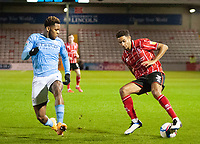 Lincoln City's Max Melbourne vies for possession with Manchester City U21's Romeo Lavia<br /> <br /> Photographer Andrew Vaughan/CameraSport<br /> <br /> EFL Papa John's Trophy - Northern Section - Group E - Lincoln City v Manchester City U21 - Tuesday 17th November 2020 - LNER Stadium - Lincoln<br />  <br /> World Copyright © 2020 CameraSport. All rights reserved. 43 Linden Ave. Countesthorpe. Leicester. England. LE8 5PG - Tel: +44 (0) 116 277 4147 - admin@camerasport.com - www.camerasport.com