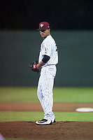 Idaho Falls Chukars relief pitcher Domingo Pena (15) prepares to deliver a pitch during a Pioneer League game against the Great Falls Voyagers at Melaleuca Field on August 18, 2018 in Idaho Falls, Idaho. The Idaho Falls Chukars defeated the Great Falls Voyagers by a score of 6-5. (Zachary Lucy/Four Seam Images)