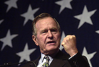 ****** Former President George Bush gestures during his speech Thursday at Cedar Crest College in Allentown. ***** Former President George Bush addresses a crowded  Republican Rally in support of his son's bid for the presidency at Cedar Crest Colleges Lee Hall on Thursday, Oct 26th. (CHUCK ZOVKO )  \ Ed please note: The EXPRESS TIMES will NOT have this angle. They were not allowed up front to get this.