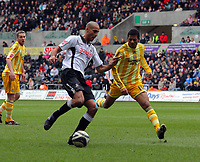 ATTENTION SPORTS PICTURE DESK<br /> Pictured: Darren Pratley of Swansea (L) against Patrick Van Aanholt of Newcastle United (R)<br /> Re: Coca Cola Championship, Swansea City Football Club v Newcastle United at the Liberty Stadium, Swansea, south Wales. 13 February 2010