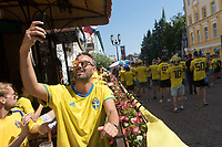 NIZHNY NOVGOROD, RUSSIA - June 18, 2018: A Sweden fans takes a selfie on Bolshaia Pokrovskaia Street with other Sweden fans before their match against South Korea at the 2018 FIFA World Cup.