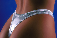Rear shot of young adult female wearing silver thong bikini. Young woman. Houston Texas.