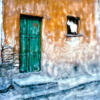 Mexican village door bright with green marks the address - 108.<br />