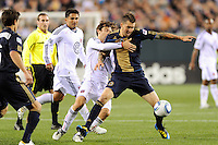 Danny Califf (4) of the Philadelphia Union holds off Carey Talley (8) of DC United. The Philadelphia Union defeated D. C. United 3-2 during a Major League Soccer (MLS) match at Lincoln Financial Field in Philadelphia, PA, on April 10, 2010.