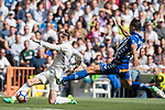 Gareth Bale (l) of Real Madrid competes for the ball with Zouhair Feddal Agharbi of Deportivo Alaves during their La Liga match between Real Madrid and Deportivo Alaves at the Santiago Bernabeu Stadium on 02 April 2017 in Madrid, Spain. Photo by Diego Gonzalez Souto / Power Sport Images