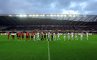 Pictured: Swansea players greet referees and Barnsley players before kick off. Tuesday 28 August 2012<br /> Re: Capital One Cup game, Swansea City FC v Barnsley at the Liberty Stadium, south Wales.