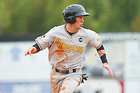 Andrew Maggi #23 of the West Virginia Power keeps his eye on the baseball as he heads towards third base during the game against the Kannapolis Intimidators at Fieldcrest Cannon Stadium on April 20, 2011 in Kannapolis, North Carolina.   Photo by Brian Westerholt / Four Seam Images