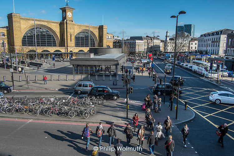 Pedestrians and traffic on Euston Road outside Kings Cross station, London.
