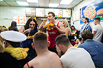 © Joel Goodman - 07973 332324 . 27/12/2017. Wigan, UK. People eat a takeaway. Revellers in Wigan enjoy Boxing Day drinks and clubbing in Wigan Wallgate . In recent years a tradition has been established in which people go out wearing fancy-dress costumes on Boxing Day night . Photo credit : Joel Goodman