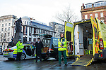 © Joel Goodman - 07973 332324 . 19/12/2014 .  Manchester , UK .  Police Sergeant John Brennan , Undertaker Leyton Moores and Paramedic Jo Hodson . Emergency services photocall in Manchester City Centre , ahead of Mad Friday night , featuring an ambulance , a police car and a hearse , highlighting the travel options some revellers will face after a night out . Police say a hundred police will be patrolling in Manchester City Centre this evening (Friday 19th December) after previous reports have said as few as four have been available some nights . Photo credit : Joel Goodman