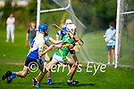 Lixnaw's Keltyn Molley about to shoot as Tralee Parnells  Conor Kirby is about to hook his effort in the Minor hurling championship quarter final.