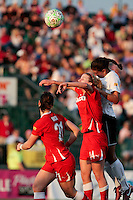 Brittany Bock (21) and Becky Edwards (14) of the Western New York Flash go up for a header with Shannon Boxx of the magicJack during the first half.  The Western New York Flash defeated the magicJack 3-0 in Women's Professional Soccer (WPS) at Sahlen's Stadium in Rochester, NY May 22, 2011.