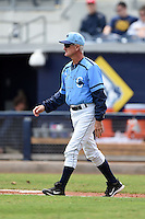 Charlotte Stone Crabs pitching coach Steve Watson (18) walks to the mound during a game against the Fort Myers Miracle on April 16, 2014 at Charlotte Sports Park in Port Charlotte, Florida.  Fort Myers defeated Charlotte 6-5.  (Mike Janes/Four Seam Images)