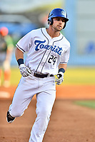Asheville Tourists first baseman Chad Spanberger (24) rounds the bases after hitting a home run during a game against the Greensboro Grasshoppers at McCormick Field on May 10, 2018 in Asheville, North Carolina. The Tourists defeated the Grasshoppers 14-10. (Tony Farlow/Four Seam Images)
