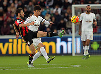(L-R) Harry Arter of Bournemouth is challenged by Ki Sung Yueng of Swansea during the Barclays Premier League match between Swansea City and Bournemouth at the Liberty Stadium, Swansea on November 21 2015