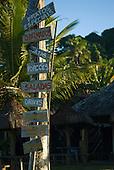 Praia da Tiririca, Itacare, Bahia State, Brazil. Beach restaurant menu painted on wooden shingles.