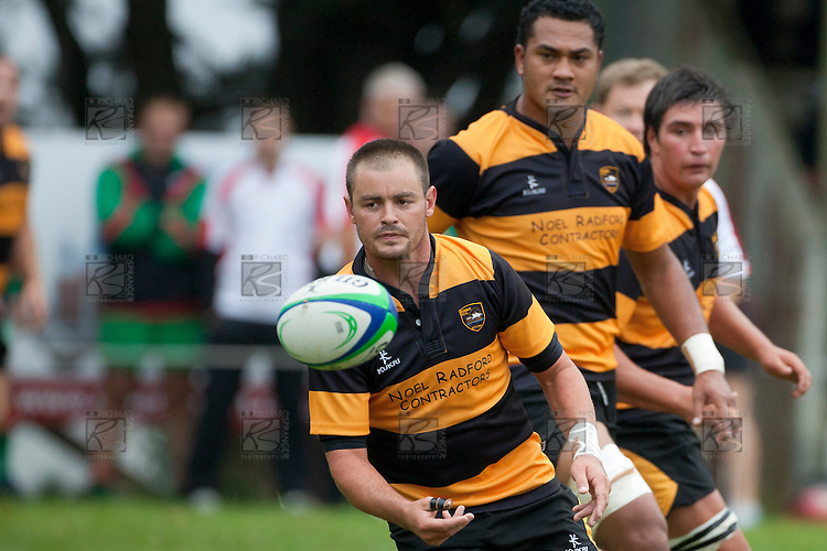 Brad Thornton looks for his outside backs as Bombay attack from inside their own half.   Counties Manukau Premier Club Rugby game between Bombay and Waiuku played up on the hill at Bombay on March 26th 2011. Waiuku won 57 - 10 after leading 24 - 3 at halftime.