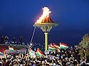 Iraq 2015 <br /> Celebration of Nowruz in wartime: The fire,the Kurdish flags,' the crowd, the signs We are all peshmerga  <br /> Irak 2015 <br /> Celebration la nuit de Nowruz a Dohok en temps de guerre: La foule, le feu, les drapeaux kurdes, les pancartes Nous sommes tous peshmerga.