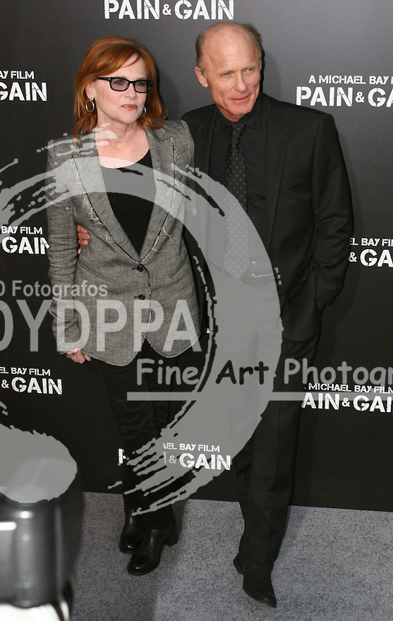 """Ed Harris; Amy Madigan.  Celebrities gathered at The TCL Chinese Theatre in Hollywood to attend the Los Angeles premiere of Paramount Picture's  PAIN & GAIN on April 22, 2013.<br /> Cast members and filmmakers attending include: Mark Wahlberg (Daniel Lugo), Dwayne Johnson (Paul Doyle), Michael Bay (Director), Anthony Mackie (Adrian Doorbal), Rebel Wilson (Robin Peck), Ed Harris (Ed Du Bois), Tony Shalhoub (Victor Kershaw), Rob Corddry (John Mese), Ken Jeong (Jonny Wu), Bar Paly (Sorina Luminita), Christopher Markus (Screenwriter), Stephen McFeely (Screenwriter), Donald DeLine (Producer)<br /> ABOUT PAIN & GAIN: <br /> From acclaimed director Michael Bay comes """"Pain & Gain,"""" a new action comedy starring Mark Wahlberg, Dwayne Johnson and Anthony Mackie. Based on the unbelievable true story of a group of personal trainers in 1990s Miami who, in pursuit of the American Dream, get caught up in a criminal enterprise that goes horribly wrong. Release Date:  April 26, 2013. Photo by Hilda Lazarte/ Unimedia/ DyD Fotografos"""