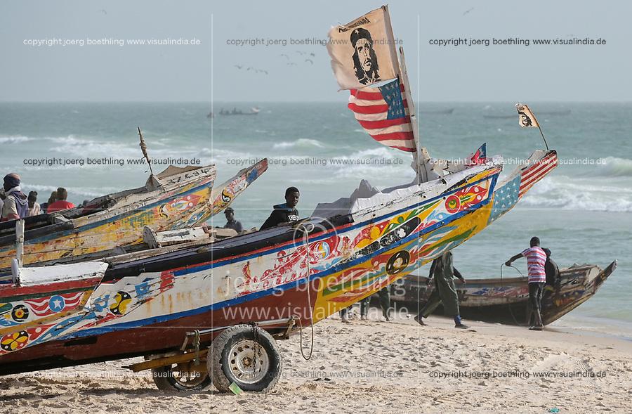 MAURITANIA, Nouakchott, atlantic ocean, fishing harbour, coast fisherman, boat with US Flag and image of cuban freedom fighter Che Guevara / MAURETANIEN, Nuakschott, Fischerhafen, atlantischer Ozean, Küstenfischer