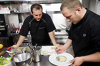 Gaël (left) and Mickaël (right) Tourteaux prepare dishes in the kitchen of their restaurant 'Flaveur', Nice, France, 10 April 2012