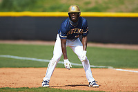 Broadus Roberson (39) of the Queens Royals takes his lead off of first base during game two of a double-header against the Catawba Indians at Tuckaseegee Dream Fields on March 26, 2021 in Kannapolis, North Carolina. (Brian Westerholt/Four Seam Images)