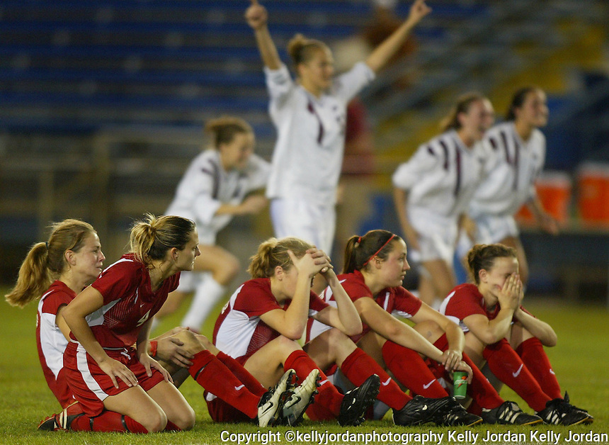 The Seabreeze soccer team reacts as they lose their Class 4A State final game to Tarpon Springs in penalty kicks after two overtimes and penalty kicks Saturday February 21, 2004.(Kelly Jordan)