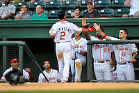 Center fielder Andrew Benintendi (2) of the Greenville Drive is congratulated after scoring in a game against the Greensboro Grasshoppers on Wednesday, August 26, 2015, at Fluor Field at the West End in Greenville, South Carolina. Benintendi is a first-round pick of the Boston Red Sox in the 2015 First-Year Player Draft out of the University of Arkansas. Greenville won, 7-0. (Tom Priddy/Four Seam Images)