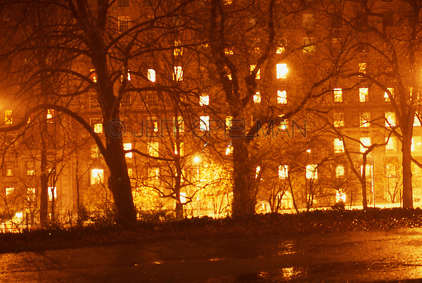 THIS IMAGE IS AVAILABLE FROM GETTY IMAGES FOR COMMERCIAL AND EDITORIAL LICENSING.  Please search for image # 200184787-001 on www.gettyimages.com.<br /> <br /> Illuminated Apartment Building on Fifth Avenue viewed thru Bare Trees in Central Park at Night, Late Autumn, New York City, New York State, USA