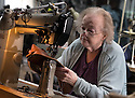 """01/05/16<br /> <br /> Pat Halliwell has been working with the company for more than 50 years and machine stitches (""""closes"""") the leather to form the basic shoe shape.<br /> <br /> Fuelled by a growing trend for vintage cycling, England's last remaining heavy duty boot-maker, tucked away in the heart of the Derbyshire Peak District, is pedalling a new style of footwear.<br /> <br /> Full story here: http://www.fstoppress.com/articles/vintage-cycle-shoes/<br /> <br />  .For hipster retro-cycling enthusiasts after the authentic vintage look, it's the only English manufacturer of leather shoes designed to work with old-fashioned bike pedal clips.<br /> <br /> For well over a century the family-run firm William Lennon and Co has been hand-making safety boots for the surrounding quarry and lead mining industries.<br /> <br /> And now it is applying the same high level of traditional skill and quality to old-style cycle shoes.<br /> <br /> Located in the small village of Stoney Middleton, the company produces more than 500 pairs of work boots a week and started to make the toe-clip cycle shoes around seven years ago, when the only other manufacturer in Leeds shut down.<br /> <br /> <br /> All Rights Reserved: F Stop Press Ltd. +44(0)1335 418365   www.fstoppress.com."""