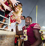Florida State running back Karlos Williams leaves the field after scorning the game winning touchdown in overtime of an NCAA college football game against Clemson in Tallahassee, Fla., Saturday, Sept. 20, 2014.  Florida State defeated Clemson 23-17 in overtime.  (AP Photo/Mark Wallheiser)