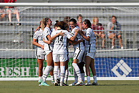 CARY, NC - SEPTEMBER 12: Sophia Smith #9 of the Portland Thorns FC is mobbed by teammates after scoring a goal during a game between Portland Thorns FC and North Carolina Courage at Sahlen's Stadium at WakeMed Soccer Park on September 12, 2021 in Cary, North Carolina.