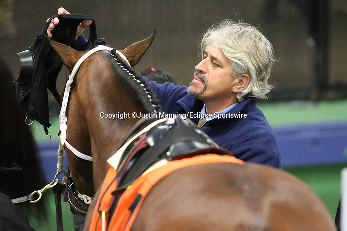 March 14, 2020: Trainer/owner Steven Asmussen saddling Impact Player before the start of the 7th race at Oaklawn Racing Casino Resort in Hot Springs, Arkansas. ©Justin Manning/Eclipse Sportswire/CSM