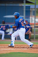 GCL Mets first baseman Wilfred Astudillo (80) follows through on a swing during a game against the GCL Marlins on August 3, 2018 at St. Lucie Sports Complex in Port St. Lucie, Florida.  GCL Mets defeated GCL Marlins 3-2.  (Mike Janes/Four Seam Images)