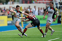 Tom Williams of Harlequins is tackled by David Strettle of Saracens  during the Aviva Premiership semi final match between Saracens and Harlequins at Allianz Park on Saturday 17th May 2014 (Photo by Rob Munro)