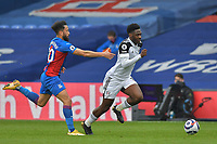 Ola Aina of Fulham goes past Andros Townsend of Crystal Palace during the Premier League behind closed doors match between Crystal Palace and Fulham at Selhurst Park, London, England on 28 February 2021. Photo by Vince Mignott / PRiME Media Images.
