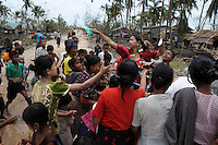 Rice and sweets are distributed to a village devastated by Cyclone Nargis, which hit Burma in May 2008. Private donations had been forbidden by the junta, who insisted that all aid must be distributed through them. These people decided to do it anyway.