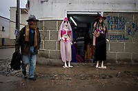 .An old man walking infront of a store in El Alto.Just 25 years ago it was a small group of houses around La Paz  airport, at an altitude of 12,000 feet. Now El Alto city  has  nearly one million people, surpassing even the capital of Bolivia, and it is the city of Latin America that grew faster .<br /> It is also a paradigmatic city of the tubles and traumas of the country. There got refugee thousands of miners that lost  their jobs in 90 ´s after the privatization and closure of many mines. The peasants expelled by the lack of land or low prices for their production. Also many who did not want to live in regions where coca  growers and the Army  faced with violence.<br /> In short, anyone who did not have anything at all and was looking for a place to survive ended up in El Alto.<br /> Today is an amazing city. Not only for its size. Also by showing how its inhabitants,the poorest of the poor in one of the poorest countries in Latin America, managed to get into society, to get some economic development, to replace their firs  cardboard houses with  new ones made with bricks ,  to trace its streets,  to raise their clubs, churches and schools for their children.