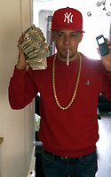 "Pictured: Liam Wall in a picture showing him holding wads of cash and a mobile phone, South Wales Police handout.<br /> Re: 'Untouchable' drugs gang jailed for almost 30 years<br /> Four members of a drugs gang have been jailed after police seized almost £30,000-worth of drugs and several thousands in cash during a lengthy and complex investigation.<br /> Liam Wall, 27, Lee Smith, 28, Connor Morse, 21, and Christopher Elgafari, 25, all pleaded guilty to four counts of conspiring to supply crack cocaine, heroin, cocaine, amphetamine and cannabis. They were sentenced today at Cardiff Crown Court.<br /> Wall, from St Mellons, was sentenced to nine years and seven months; Smith and Morse, from Grangetown and Pentwyn respectively, were both handed eight years terms; and Elgifari, from Pentwyn, was jailed for three years and seven months.<br /> The Organised Crime Team in Cardiff had been investigating the gang since September 2015, and worked painstakingly to compile a compelling case which proved the gang were operating a near-24/7 operation, flooding the street of south Wales with illegal drugs.<br /> The criminal enterprise – which the gang dubbed 'Lewis' – had the potential to make them thousands of pounds per day.<br /> Officer in the case, DC Rod Lewis said ""This was a difficult and protracted case dealing with a large drugs gang operating across Cardiff. Our aim was to totally disrupt this gang and stop them selling drugs in Cardiff.  Wall and Smith were the leaders of this gang and it was due to the amount of compelling evidence we gathered against them that they pleaded guilty to all charges.<br /> ""Their belief that they were untouchable was their undoing. They were happy to pose for photographs with large quantities of drugs or cash, which for me as the investigating officer was great evidence.""<br /> DS Dave Bancroft added: ""This gang would leave calling cards at hostels across the city to generate more business. They were a real issue for us and from the start we set about disrupting every"