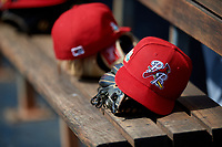 Palm Beach Cardinals hat and glove on the bench during a Florida State League game against the Charlotte Stone Crabs on April 14, 2019 at Charlotte Sports Park in Port Charlotte, Florida.  Palm Beach defeated Charlotte 5-3.  (Mike Janes/Four Seam Images)