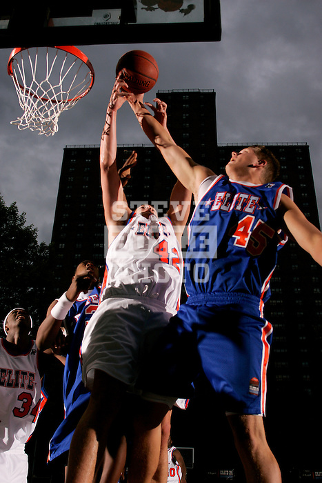 Cole Aldrich (45) and Kevin Love (42) go up for a rebound during the Elite 24 Hoops Classic game on September 1, 2006 held at Rucker Park in New York, New York.  The game brought together the top 24 high school basketball players in the country regardless of class or sneaker affiliation.