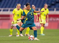 TOKYO, JAPAN - JULY 24: Sam Kerr #2 of Australia takes a penalty shot during a game between Australia and Sweden at Saitama Stadium on July 24, 2021 in Tokyo, Japan.