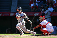 Dustin Pedroia of the Boston Red Sox at bat in front of catcher Mike Napoli (44) during a game against the Los Angeles Angels in a 2007 MLB season game at Angel Stadium in Anaheim, California. (Larry Goren/Four Seam Images)