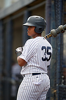 GCL Yankees West third baseman Jose Martinez (35) on deck during a game against the GCL Tigers West on August 10, 2018 at Yankee Complex in Tampa, Florida.  GCL Yankees West defeated GCL Tigers West 6-5.  (Mike Janes/Four Seam Images)