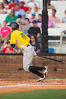 Jordan George (10) of the Bristol Pirates follows through on his swing against the Johnson City Cardinals at Howard Johnson Field at Cardinal Park on July 6, 2015 in Johnson City, Tennessee.  The Cardinals defeated the Pirates 8-2 in game two of a double-header. (Brian Westerholt/Four Seam Images)