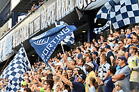 KANSAS CITY, KS - JULY 31: Sporting KC fans waving flags during a game between FC Dallas and Sporting Kansas City at Children's Mercy Park on July 31, 2021 in Kansas City, Kansas.