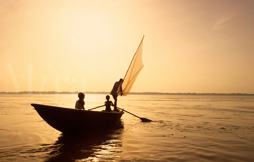 India. Varanasi.  Fishing boat working on the River Ganges in the early morning, near to the famous Ganges Ghats.